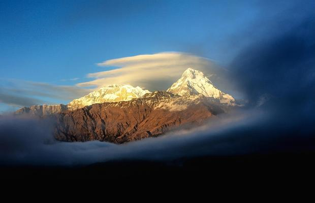 South Wales Argus: Above the clouds at sunset. Watching the golden hour at Annapurna mountain range Nepal.
