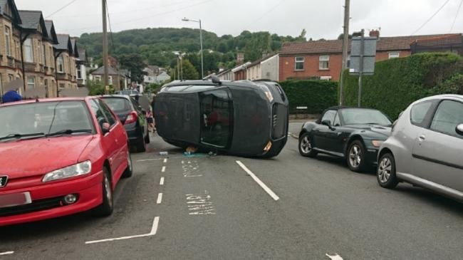 Driver arrested on suspicion of drink-driving after car flips onto side in residential street. Picture: Gwent Police/Twitter