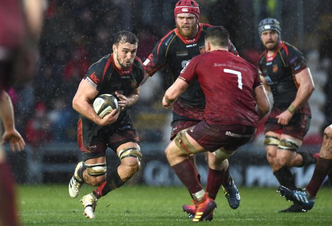 TESTING CONDITIONS: Dragons flanker Ollie Griffiths on the charge in the rain against Munster