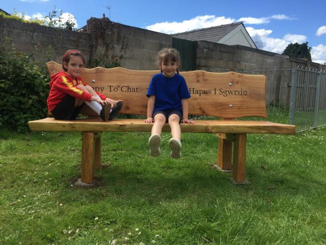 Immy and Sofia enjoying the new Happy to Chat bench in Usk Park