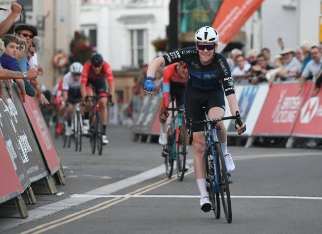 GREAT RIDE: Matt Bostock crosses the line to win the HSBC British Cycling Elite Circuit Series/Wales Open Criterium race in Aberavenny town centre on Friday night. Picture: Larry Hickmott/VeloUK