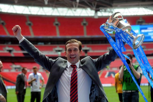 WINNER: Justin Edinburgh celebrates winning promotion with Newport County at Wembley in 2013