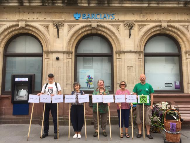 Members of the Abergavenny branch of Extinction Rebellion protesting outside the town's Barclays bank, July 2019. Picture: XR