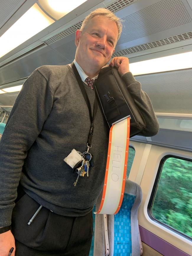Chris Edwards, 56, the 'singing conductor' making his way through the train to check tickets