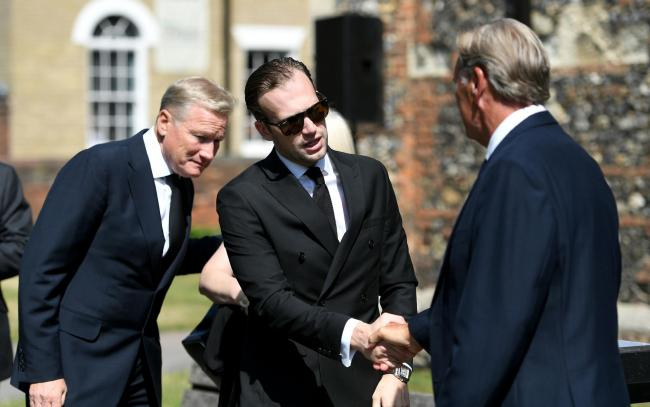 MEMORIAL: Charlie Edinburgh shakes hands with Glenn Hoddle at the memorial service for his dad Justin