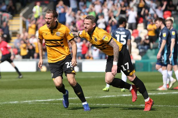 STAYING: Mickey Demetriou, left, is determined to help Newport County win promotion after signing a new contract