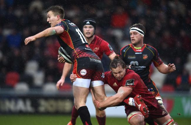 TOUGH TUSSLE: Full-back/wing Will Talbot-Davies on the run against Munster in the PRO14 last season. The Dragons will host the Irish province at Rodney Parade in the Celtic Cup later this month.