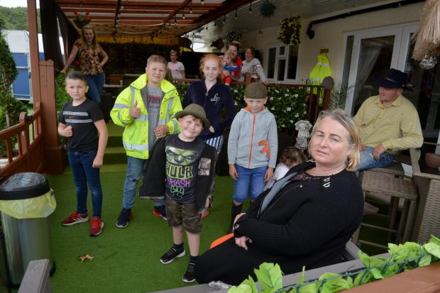 South Wales Argus: Colleen Rogers with residents of the Brickyard Lane home in Newport.