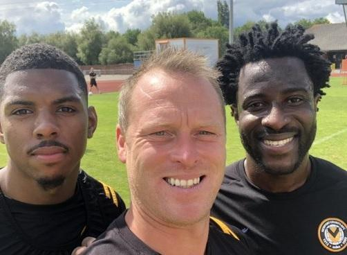 TRAINING: Wilfried Bony, right, with Michael Flynn, centre, and Newport County striker Tristan Abrahams. Picture: @flynnster17