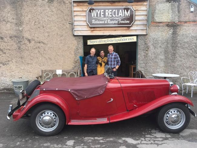 Wye Reclaim shop owner David Davies, Celebrity Antiques Road Trip expert Roo Irvine and contestant Adam Henson infront of the vintage car used in the episode. Picture: Wye Reclaim Facebook page