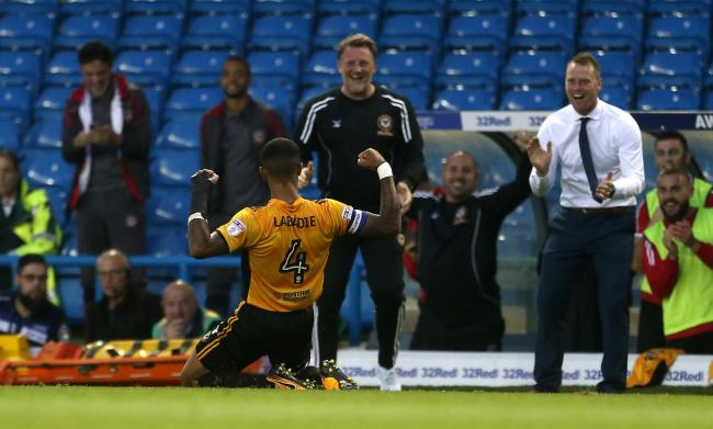 JOY: Captain Joss Labadie celebrates with Newport County boss Michael Flynn, right, and assistant Wayne Hatswell at Leeds United in August 2017