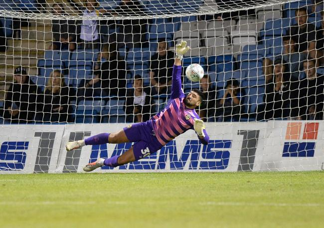 SAVE: Newport County goalkeeper Nick Townsend saves in the shootout as the Exiles beat Gillingham on penalties to seal a tie against West Ham United in round two of the Carabao Cup