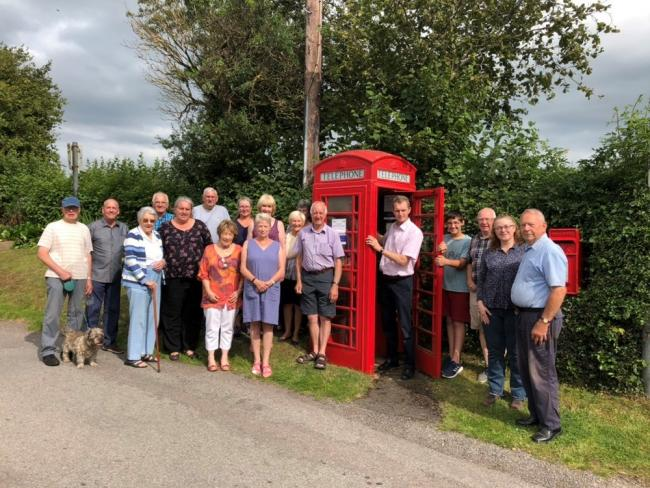 Bryn-y-Gwenin vilagers with David Davies MP (in phone box). Picture: David Davies