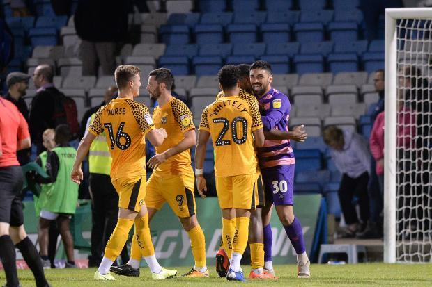 LAST GASP: County players celebrate after the penalty shoot-out win at Gillingham