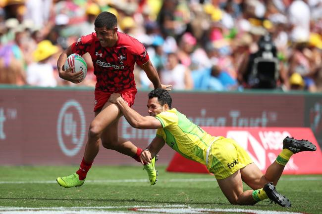 Wales' Rio Dyer charges through the Australia defense on day one of the HSBC World Rugby Sevens Series in Hamilton on 26 January, 2019. Photo credit: Mike Lee - KLC fotos for World Rugby.