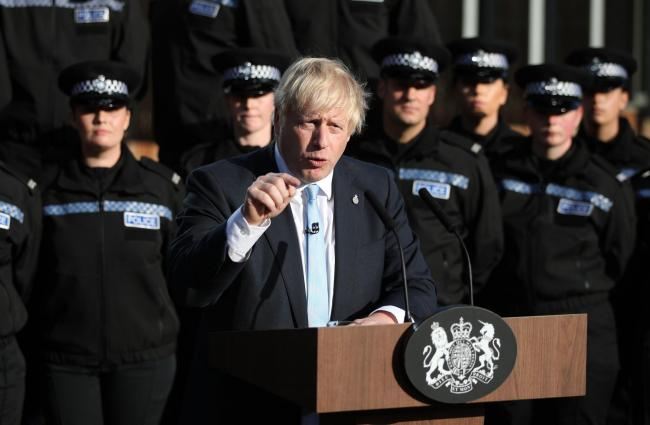 Prime Minister Boris Johnson making a speech after the government promised £750 million to fund the first year of a plan to recruit an extra 20,000 police officers, September 2019. Picture: Danny Lawson/PA Wire