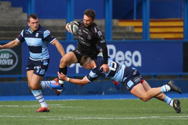 ON THE RUN: Full-back Jordan Williams in the Dragons' Celtic Cup loss to Cardiff Blues