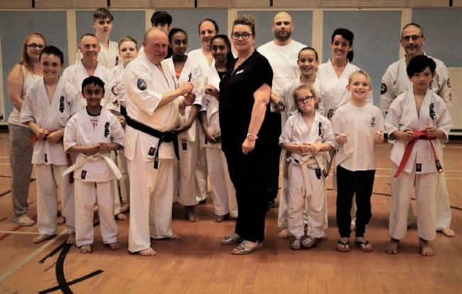 Cwmbran Karate Kyokushinkai with Ellen Hagland, customer advisor at Pavers in Ebbw Vale. Picture: The Pavers Foundation