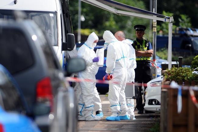 PROBE: Police officers at the scene of the alleged murder. (Credit: Wales News)