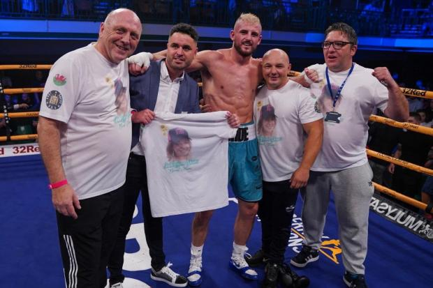 10 OUT OF 10: Kody Davies, centre, celebrates with his team. Picture: Twitter @frankwarren_tv