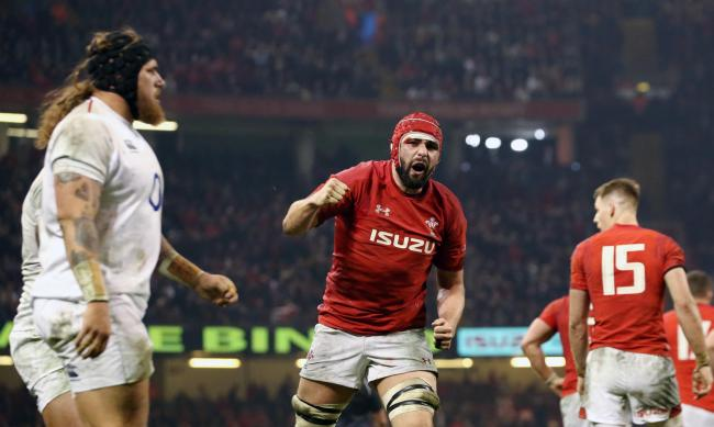 Wales' Cory Hill celebrates scoring his side's first try of the game during the Guinness Six Nations match at the Principality Stadium, Cardiff..
