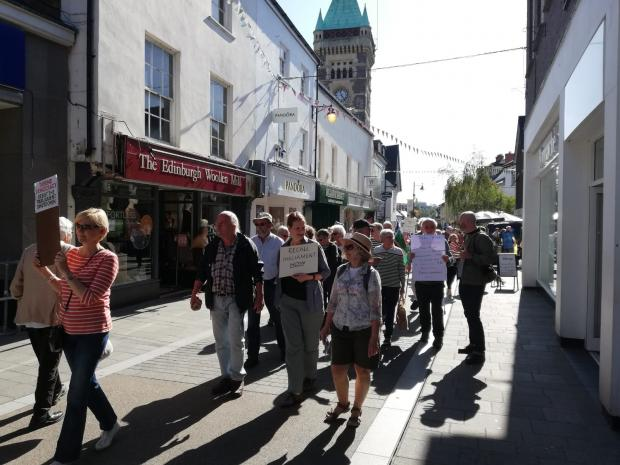 South Wales Argus: Marchers make their way along High Street, Abergavenny.
