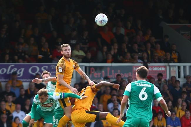 BATTLE: Newport County defender Mark O'Brien in action against Plymouth Argyle at Rodney Parade last month