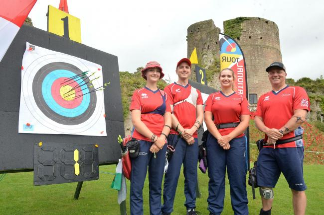 ON TARGET: Cwmbran's Thea Rogers, left, and Dave Phillips, right, at Caldicot Castle with Tom Hall and Ella Gibson