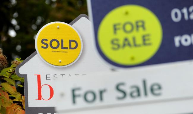 File photo dated 14/10/14 of estate agents sold and for sale signs.