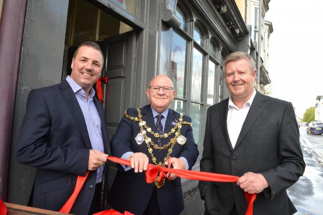 Opening of the refurbished Rest Bite Cafe on Lower Dock Street, Newport L-R Karl O'Dare, Mayor William Routley and Darra O'Flaherty . www.christinsleyphotography.co.uk