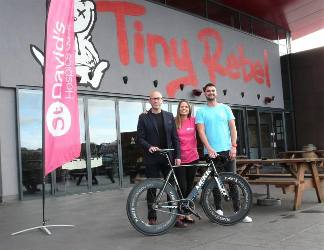 Cheers: Tania Ansell, of St David's Hospice Care (centre) with Steve Sulley (left) or Cyclone 24 Newport and Brad Cummings, of Tiny Rebel, at the brewery in Rogerstone, Newport