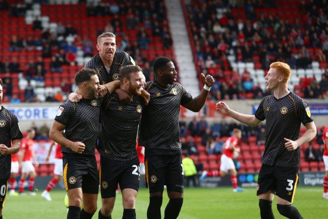 TOGETHER: Newport County defender Mark O'Brien celebrates his goal with teammates at Swindon Town