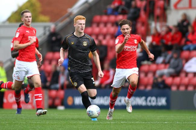 ATTACK: Newport County defender Ryan Haynes takes the fight to Swindon Town on Saturday