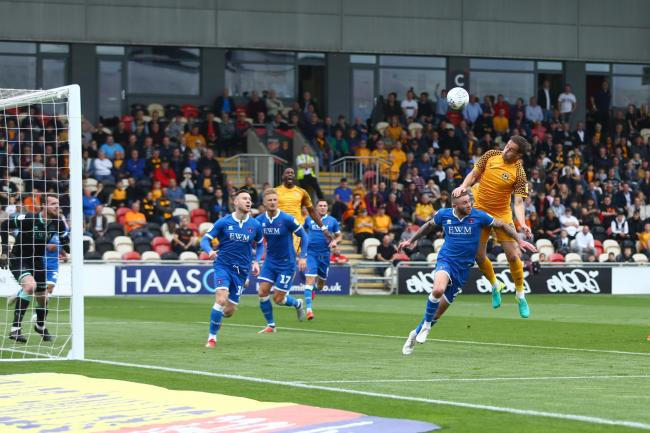 BATTLE: Matty Dolan wins a high ball for Newport County against Carlisle United. Pictures: Huw Evans Agency