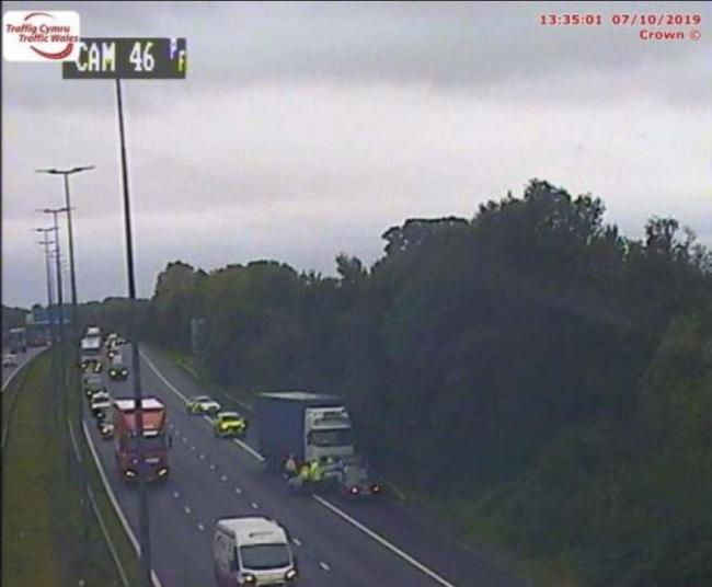 A Traffic Wales camera showing the crash on the westbound carriageway of the M4 near Junction 23A (Magor Services).