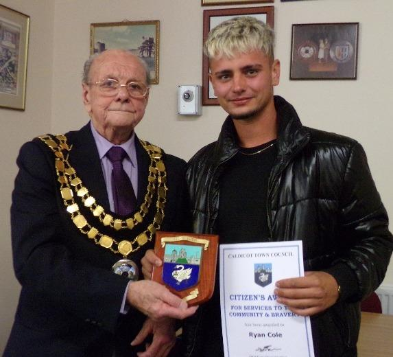 Caldicot's mayor Cllr David Evans presents Ryan Cole with the citizens award.