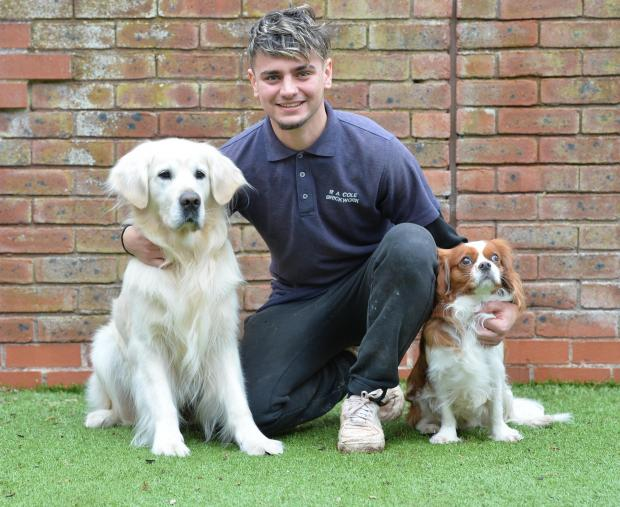 South Wales Argus: Ryan Cole with the dogs he rescued from a house fire in Caldicot in January. Picture: www.christinsleyphotography.co.uk