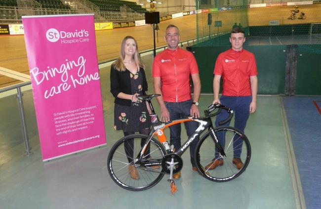 Ready: Paul Jones, of Insight Law (centre) with colleague Ryan Price and Tania Ansell, of St David's Hospice Care (right) at the Geraint Thomas Velodrome, Newport. Picture: DBPR