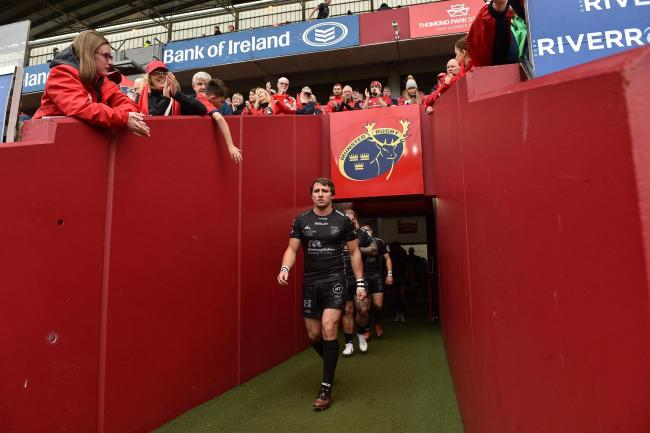 SKIPPER: Captain Rhodri Williams leads out the Dragons at Munster