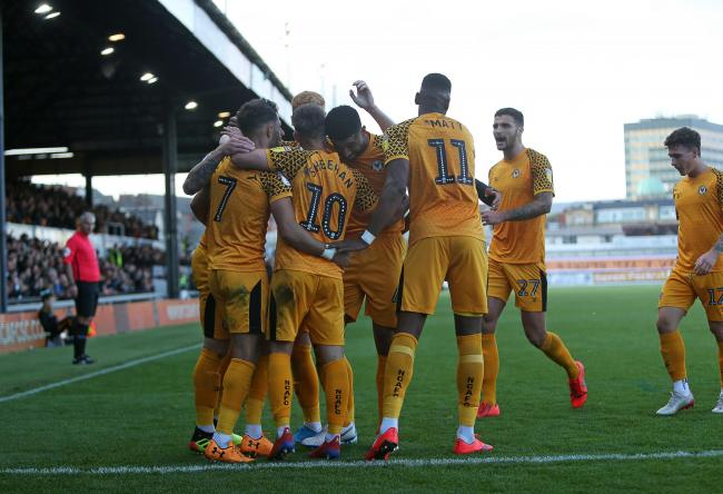 VICTORY: Newport County players celebrate Josh Sheehan's winning goal against Scunthorpe United on Saturday