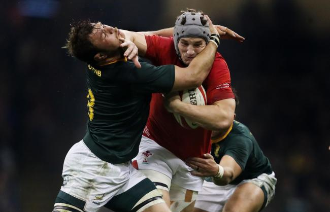Wales' Jonathan Davies is tackled by South Africa's Duane Vermeulen and Handre Pollard during the Autumn International at The Principality Stadium, Cardiff. PRESS ASSOCIATION Photo. Picture date: Saturday November 24, 2018. See PA story RUGBYU Wal