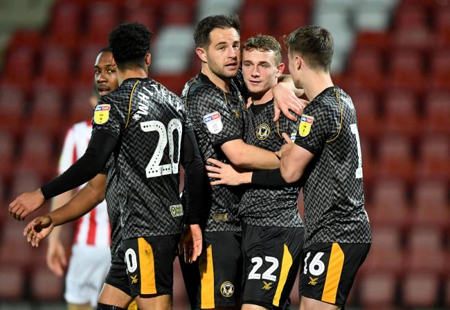 VICTORY: Matty Dolan and Taylor Maloney, centre, were both on target for Newport County at Cheltenham Town