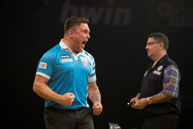 TESTY: Gerwyn Price celebrates during last year's Grand Slam of Darts final. Picture: Lawrence Lustig