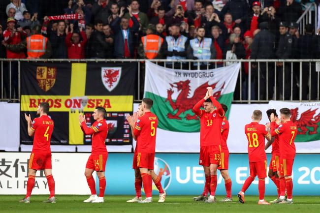 VICTORY: Wales players celebrate their 2-0 win in Azerbaijan