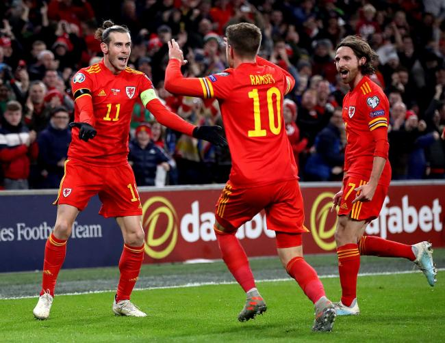 OPENER: Aaron Ramsey celebrates with Gareth Bale and Joe Allen after his goal put Wales 1-0 up against Hungary