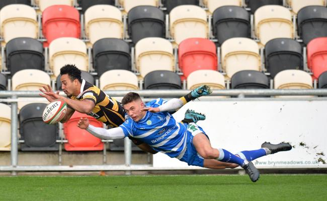 TRY TIME: Jon Morris wins the race to the ball for Newport against Bridgend earlier this month
