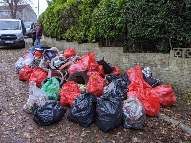 The bags of rubbish collected from the footpath.