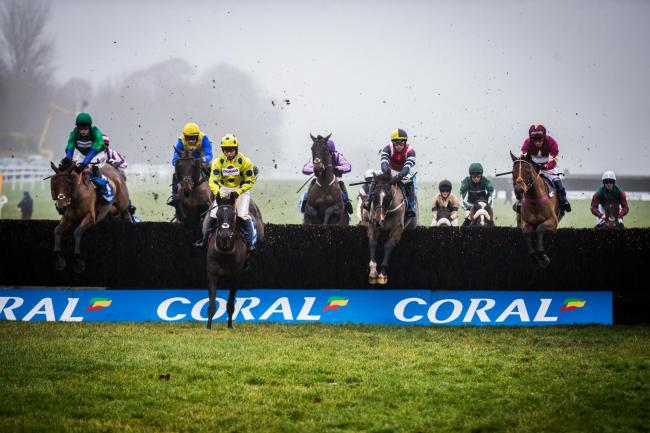 CHAMPION: Potters Corner (hooped sleeves) on his way to victory in the 2019 Coral Welsh Grand National