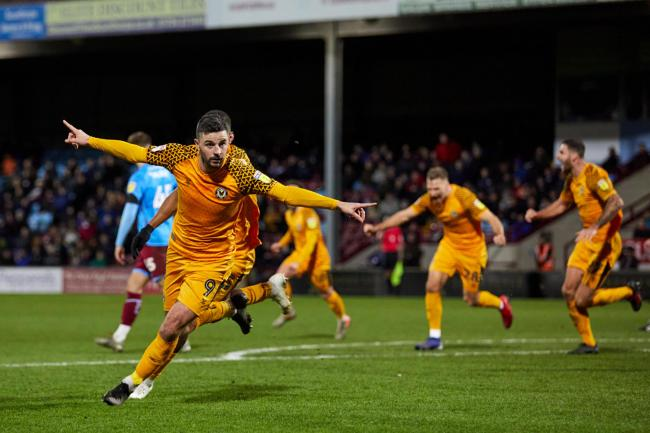 VICTORY: Padraig Amond celebrates hitting the winner for Newport County at Scunthorpe United