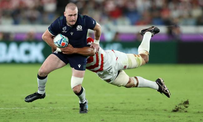 Stuart Hogg, pictured being tackled by Japan's Michael Leitch during the 2019 Rugby World Cup, has been named Scotland captain for the Six Nations.